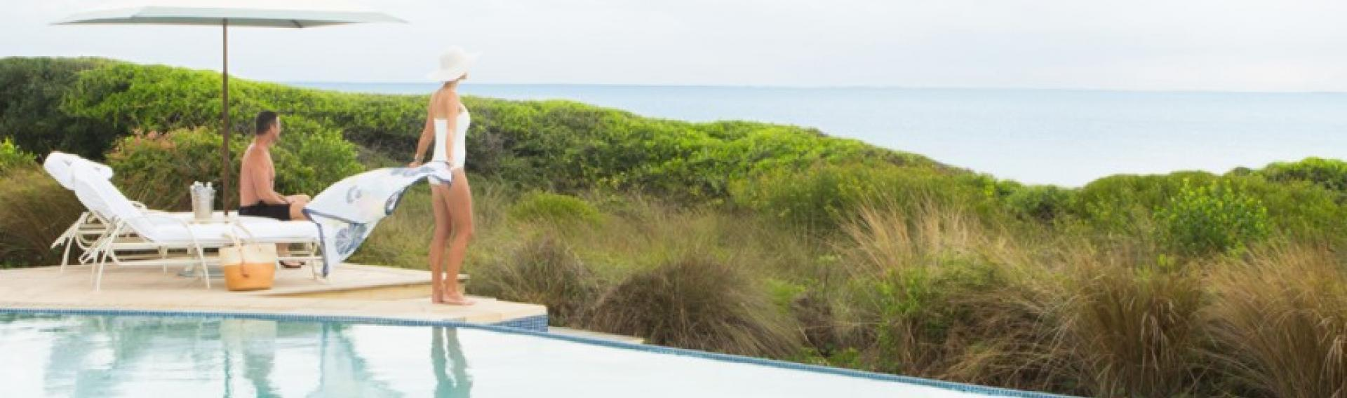 View of two people at the pool over looking the ocean, Kiawah Island South Carolina CME CLE CE destination.